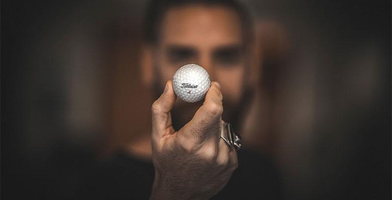 man holding golf ball