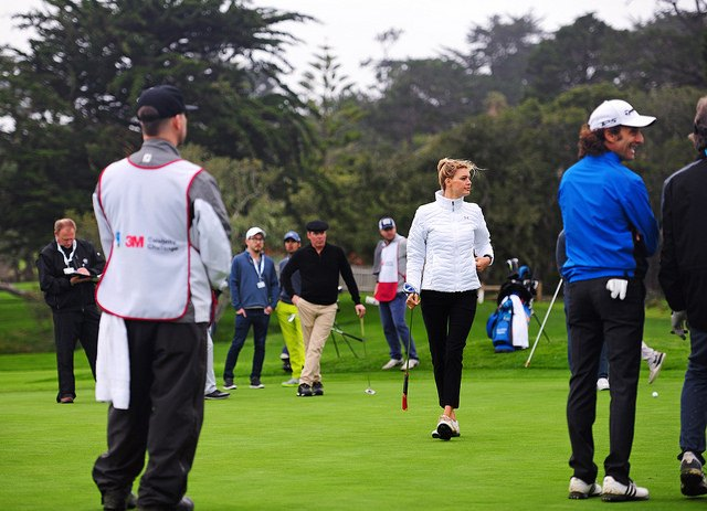 Men and Women Playing Golf for a Golf Business and Celebrity Challenge