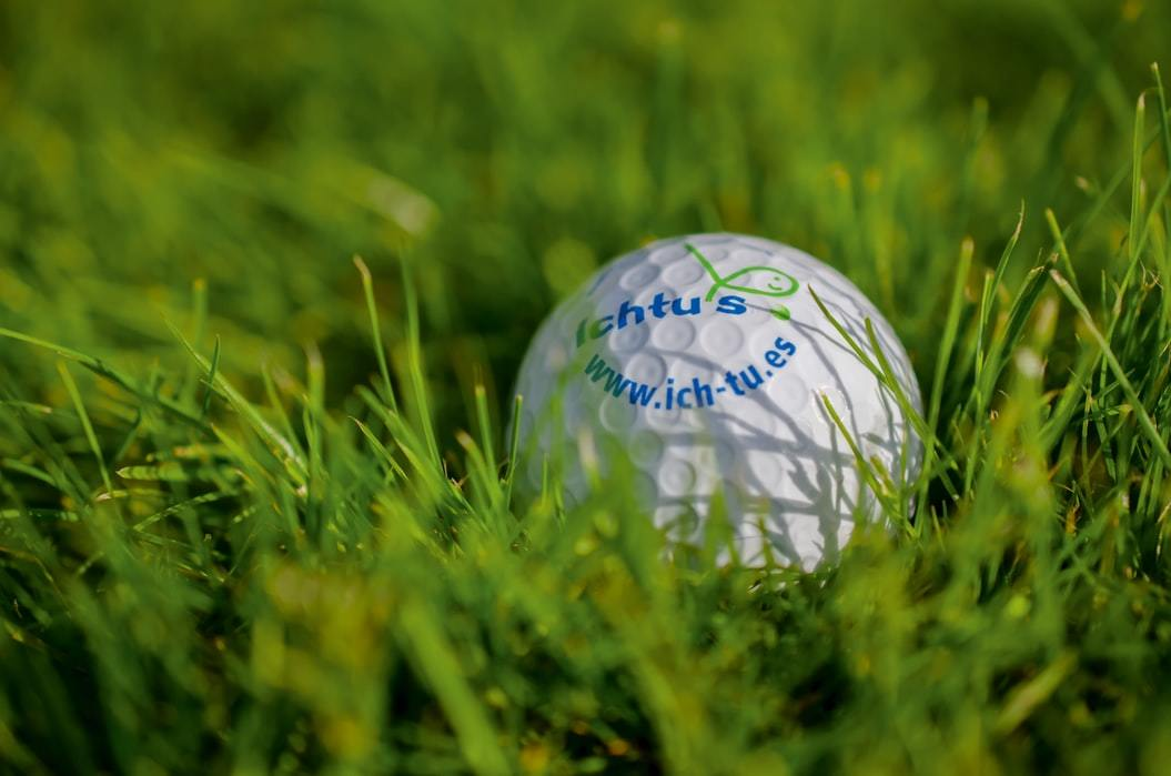selective focus photo of golf ball