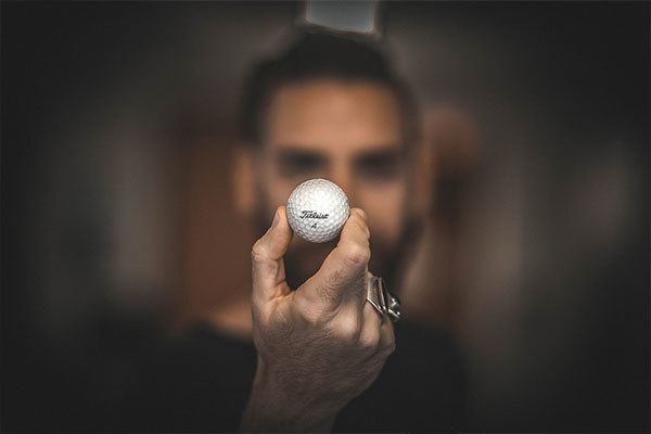 golf director holding golf ball