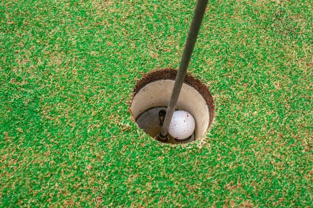 golf ball inside a hole