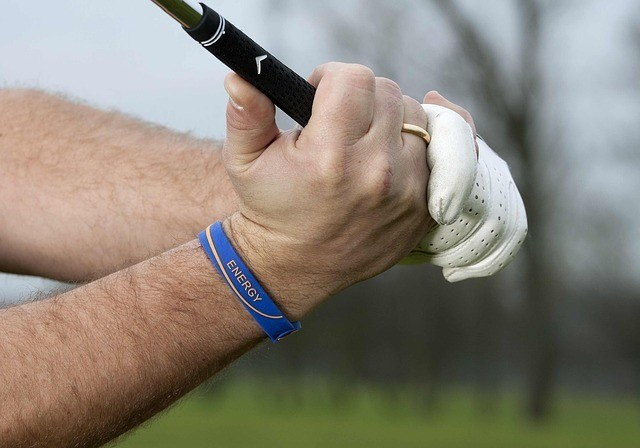 a man about to swing the golf club using one of the best golf grips and glove