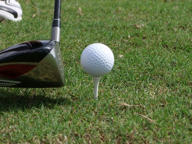 snell golf ball review: golf ball about to be hit with a golf club